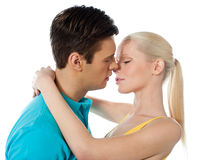 Young couple hugging and kissing. On white background Stock Photo