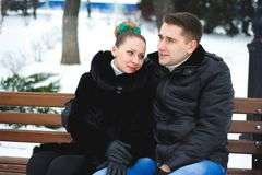 Young couple hugging and kissing in the Park in winter. royalty free stock images