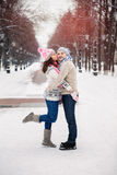 Young couple hugging and kissing in the Park in winter. stock photography