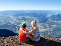 Young Couple Hugging at Mountain Top. Stock Photo