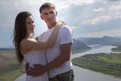 Young Couple hugging in mountains Stock Photography
