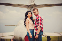Young couple hugging near the aircraft Stock Photos