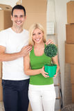 Young couple is hugging in new home Stock Photos