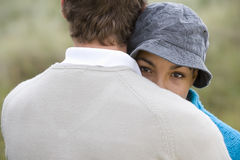 Young couple hugging outdoors, close-up stock photos