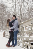 Young couple hugging outdoors in winter Stock Photos