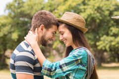 Young couple hugging in the park Stock Images