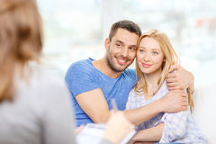 Young couple hugging at psychologist office stock photos