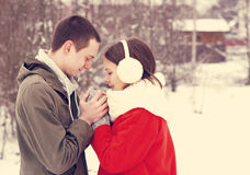 Young couple hugging by the river in winter weather Stock Image