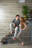 Young couple hugging while sitting on staircase Royalty Free Stock Image