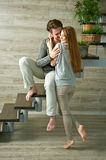 Young couple hugging while sitting on staircase Stock Photo