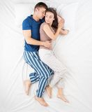 Young couple hugging while sleeping Royalty Free Stock Image
