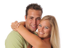 Young couple hugging and smiling Stock Images
