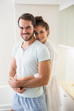 Young couple hugging and smiling at camera Stock Photography