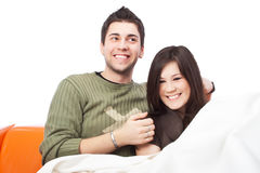 Young couple hugging on sofa Stock Photos