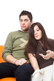 Young couple hugging on sofa at home Stock Photo