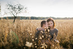 Young couple hugging at sunset Stock Image