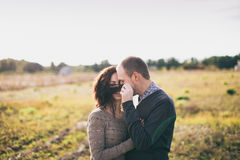 Young couple hugging at sunset Stock Photos