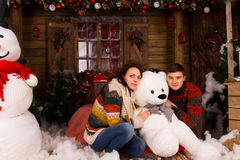 Young Couple Hugging White Winter Bear Doll Royalty Free Stock Images
