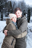 Young couple hugging in winter weather Royalty Free Stock Image