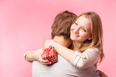 Young couple hugging with wrapped present. Stock Photos