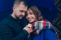 Young Couple hugs outside. Dressed in blue colours Royalty Free Stock Photo