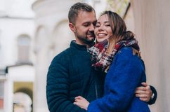 Young Couple hugs outside. Dressed in blue colours Stock Photography