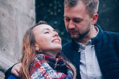 Young Couple hugs outside. Dressed in blue colours Royalty Free Stock Images