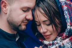 Young Couple hugs outside. Young Couple hugs oute dressed in blue colours Stock Photos