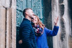 Young Couple hugs outside. Dressed in blue colours Royalty Free Stock Photos