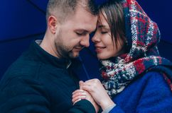 Young Couple hugs outside. Dressed in blue colours Royalty Free Stock Photography