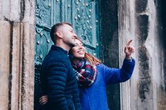 Young Couple hugs outside. Dressed in blue colours Stock Images