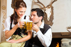 Young couple in a hunters cabin Royalty Free Stock Photos