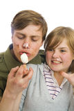 Young couple with ice-cream isolated on a white Royalty Free Stock Photos