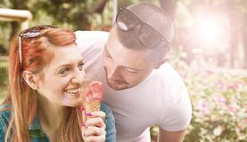 Young couple with ice cream. reflected light effect. A young couple with ice cream. reflected light effect stock images
