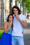 Young couple with ice creams Stock Photos