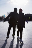 Young couple at ice rink Stock Images