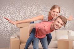 Young couple imitating flying Stock Photography