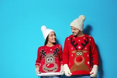 Free Young Couple In Christmas Sweaters And Knitted Hats Stock Photography - 130297312