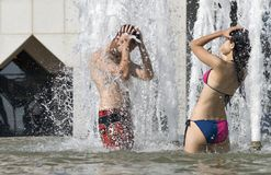 Young Couple In Fountain Stock Images