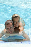 Young Couple In The Pool Stock Images