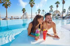 Young couple on infinity pool cocktails Stock Images