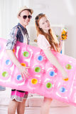 Young couple with inflatable mattress Stock Photo