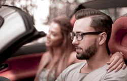 Young couple inside a convertible car for a day trip. royalty free stock photo