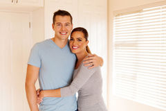 Young couple inside house Stock Images