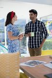 Couple interacting with each other in the office Royalty Free Stock Photography