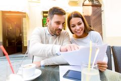 Young couple interacting while having coffee. In cafe Stock Photos