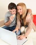 Young couple internet shopping Royalty Free Stock Photos