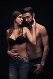 Young couple intimate woman hands touching man sexy Royalty Free Stock Photography