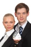 Young couple isolated holding home Royalty Free Stock Photo