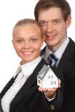 Young couple isolated holding home Royalty Free Stock Photography